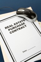 photo of a real estate purchase agreement